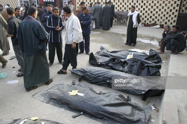Body bags are laid out with yellow label